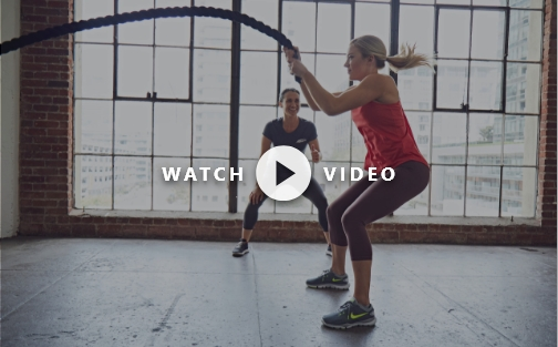 women doing battle rope exercises